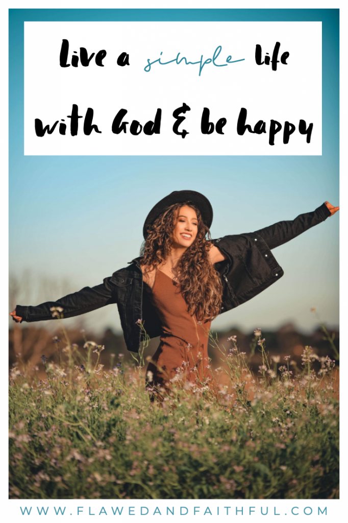 Flawed and Faithful: live a simple life with God and be happy -- girl with open arms in a field of flowers.